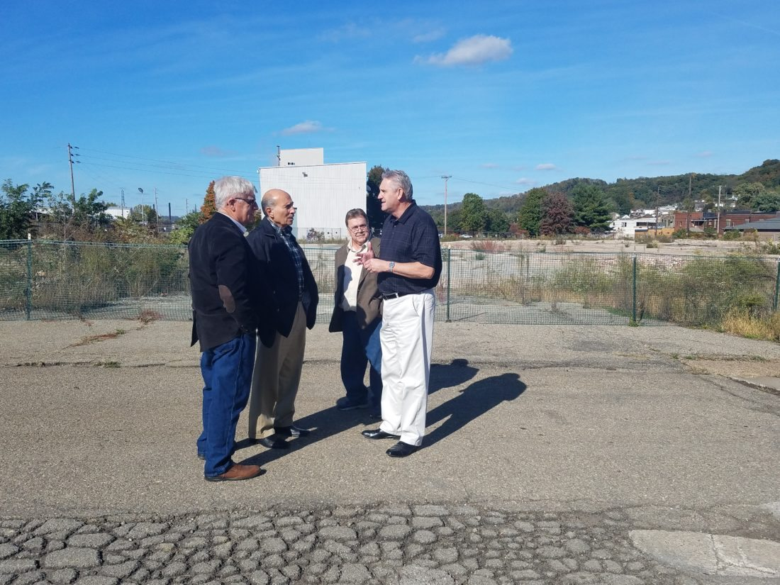 From left, Marvin Six, Business Development Corp. of the Northern Panhandle assistant director;  William D'Alesio, BDC Board of Directors chair;  Jim Andreozzi, BDC executive board member and Brooke County Commissioner; and Tim Ennis, Brooke County Commission president and BDC board member, discuss plans for the former Follansbee Steel property at the site, which was closed in 2012. The BDC  purchased the property Thursday. — Contributed