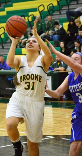 INTHEPAINT — Brooke senior Madisyn Reynolds goes up for two points during the first quarter of Thursday's season-opening win over East Liverpool, 64-42, inside the Brooke Wellness Center. (Mike Mathison)