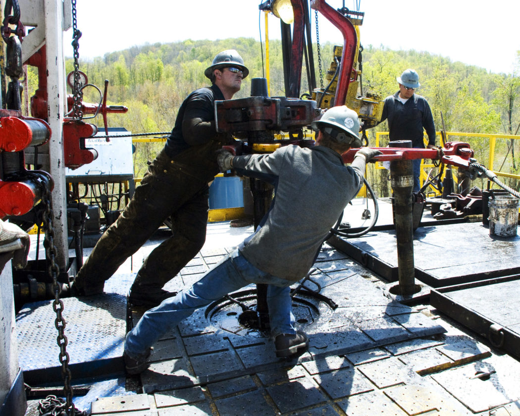 In this April 23, 2010 photo, workers move a section of well casing into place at a Chesapeake Energy natural gas well site near Burlington, Pa., in Bradford County. West Virginia Republican leaders, on Monday, vowed to work with the incoming Trump administration to push back federal energy regulations. -- Associated Press