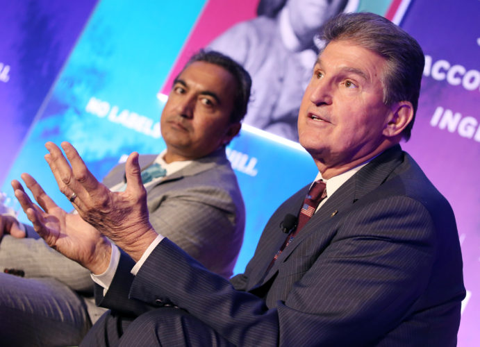 "CONGRESSIONAL PROGNOSTICATION — Sen. Joe Manchin, D-W.Va, right, and Rep. Ami Bera, D-Calif., talk about where President-elect Trump does and does not need Congress — and where the toss-ups are at a panel discussion at the ""1787: Constructing The Peace After The War"" event on Monday in Washington. -- Associated Press"