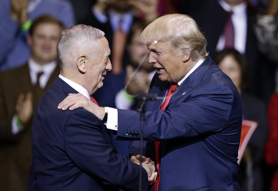 President-elect Donald Trump introduces retired Marine Corps Gen. James Mattis as his appointed Secretary of Defense while speaking to supporters during a rally in Fayetteville, N.C., Tuesday, Dec. 6, 2016. (AP Photo/Gerry Broome)