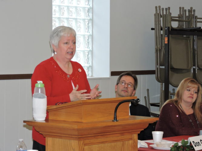 Sharon Kesselring, executive director of the Northwest West Virginia Chapter of the American Red Cross, discusses some of the agency's services, Friday, during the Weirton United Way campaign report luncheon, as Weirton United Way Board Vice President Don Gianni Jr. and Executive Director Linda Stear listen. -- Craig Howell