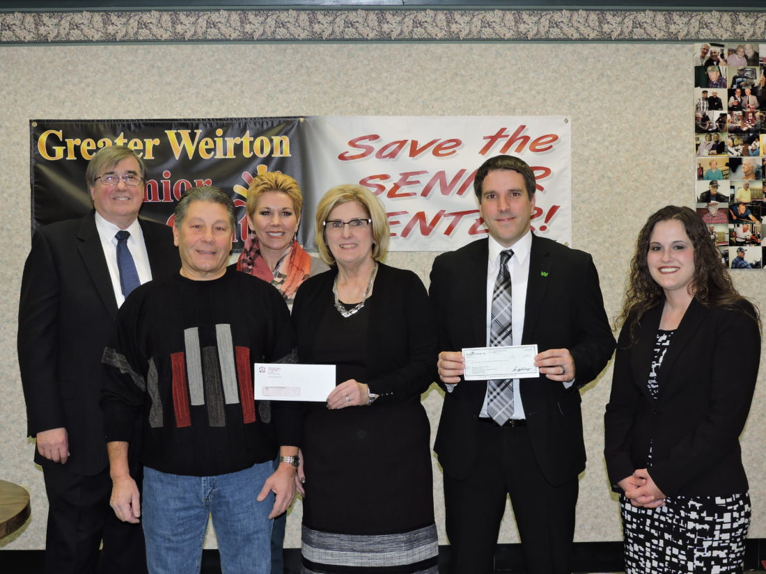 CENTER SUPPORT — A group of local businesses are renewing their support of the Greater Weirton Senior Center, presenting donations toward the center's operations on Tuesday, and encouraging others to do the same. Among those taking part are, in front from left, Senior Center Board Chair Chuck Svokas; Hancock County Savings Bank President Cathy Ferrari; Jason Lucarelli and Mallory Clegg of WesBanco, and in back, Arden Ford, senior center board member, and Kelli McCoy, director of communications for Weirton Medical Center. -- Craig Howell