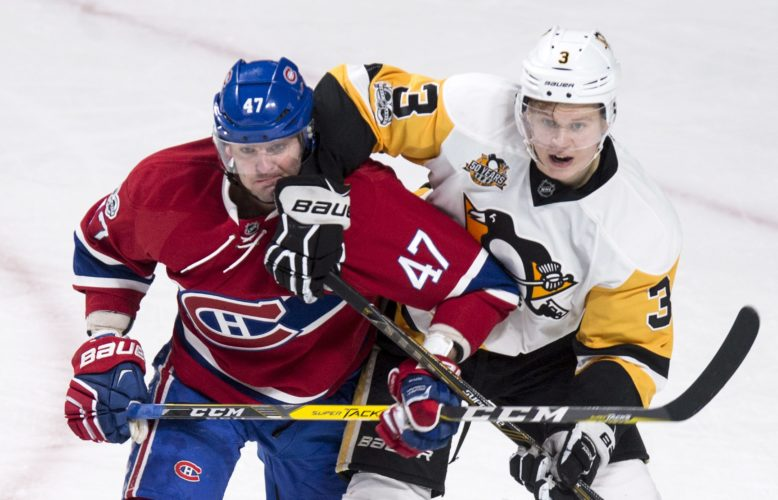 Montreal Canadiens' Alexander Radulov (47) is checked by Pittsburgh Penguins defenseman Olli Maatta during the second period of an NHL hockey game, Wednesday, Jan. 18, 2017 in Montreal. (Paul Chiasson/The Canadian Press via AP)