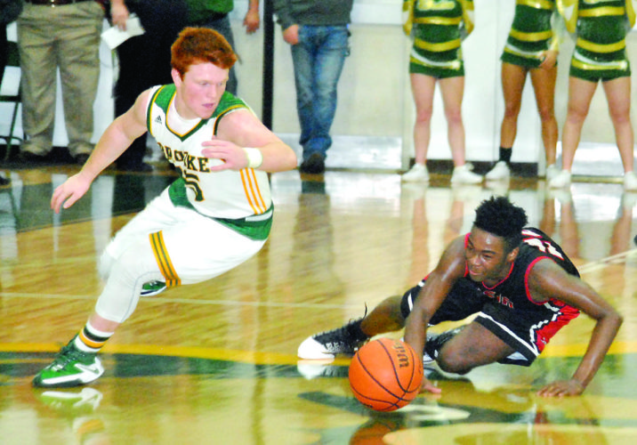 Brooke's Nick Leonard and Weir's Lyric Washington go for a loose ball during Friday's game, won by the Red Riders (Matthew Peaslee)