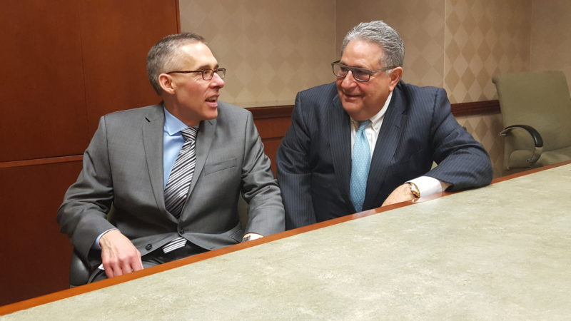 TALKING ABOUT THE AREA'S SUCCESS — John Frankovitch, left, chief executive officer of Weirton Medical Center, and Vincent Deluzio, managing director of R&V Associates, discuss during an interview in the hospital's board room the success not only of WMC but of positive regional economic indicators highlighted by the hospital's statistics. -- Paul Giannamore