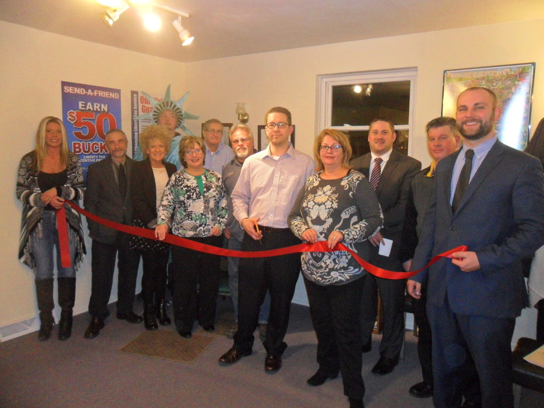 The Wellsburg Chamber of Commerce welcomed Liberty Tax Service to its latest location at 1438 Commerce St. with a ribbon-cutting ceremony. Taking part were, from left, front, chamber members Donna Conley, Tom Brown, Heather Hamilton and Kelly and Gerry Henwood; owner Tim Gilmore; Jacie Ridgely, chamber executive director; and chamber member Brian Tennant; and back, staff members Nick Hamilton and Richard Krisak and David Klick, chamber president; and Joe Mullenbach, chamber vice president.