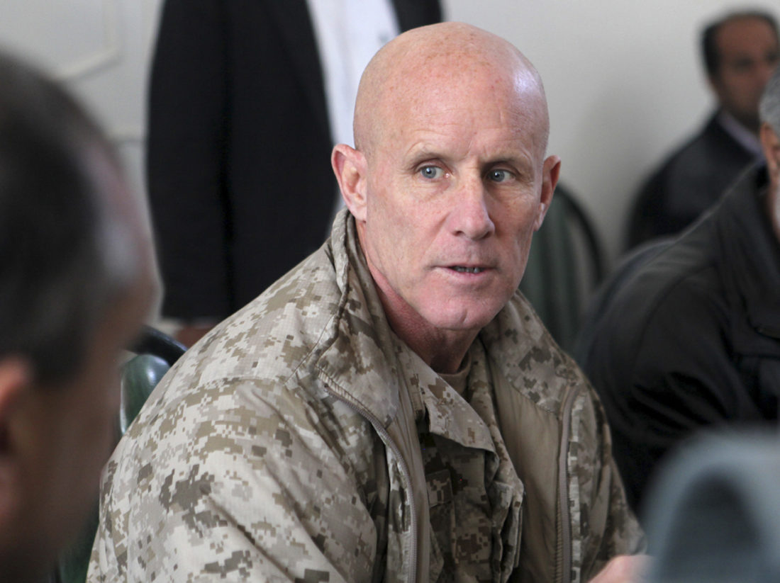 SAYS NO TO JOB — In this image provided by the U.S. Marine Corps, Vice Adm. Robert S. Harward, commanding officer of Combined Joint Interagency Task Force 435, speaks to an Afghan official during his visit to Zaranj, Afghanistan, in 2011. Harward has turned down an offer to be President Donald Trump's new national security adviser. A senior White House official said Thursday that Harward had turned the offer down due to financial and family commitments. -- Associated Press
