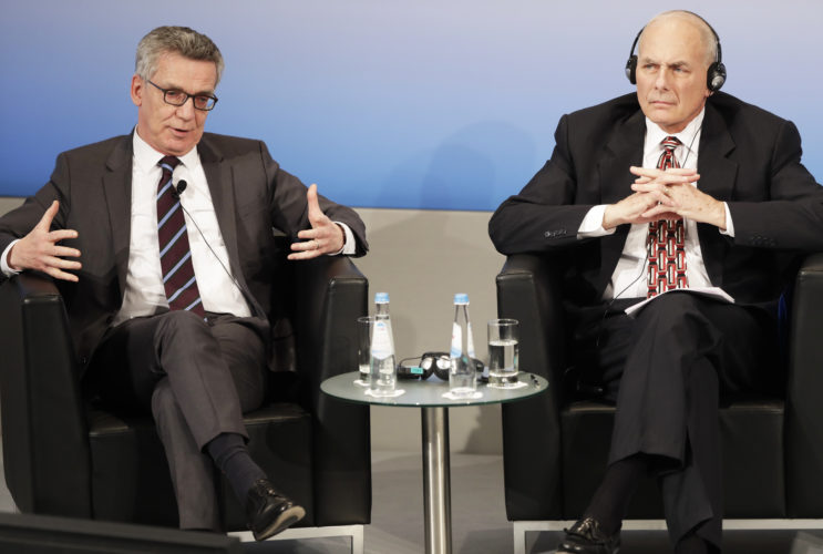 US Secretary of Homeland Security John Kelly, right, and German Interior Minister Thomas de Maiziere sit together in a panel during the Munich Security Conference in Munich, Germany, Saturday. The annual weekend gathering is known for providing an open and informal platform to meet in close quarters. -- Associated Press