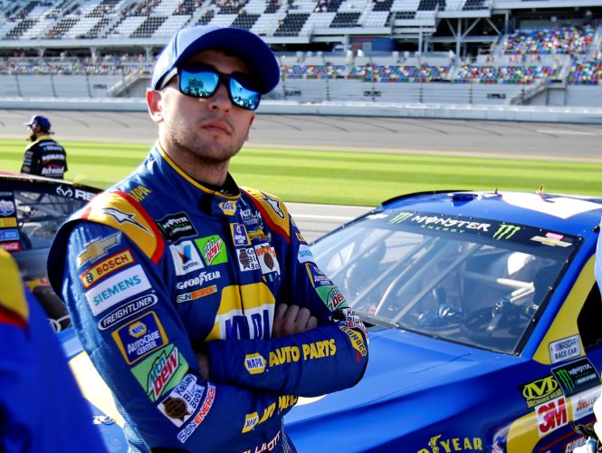 Chase Elliott looks at the leader board after a qualifying run for the NASCAR Daytona 500 auto race at Daytona International Speedway, Sunday, Feb. 19, 2017, in Daytona Beach, Fla. (AP Photo/John Raoux)