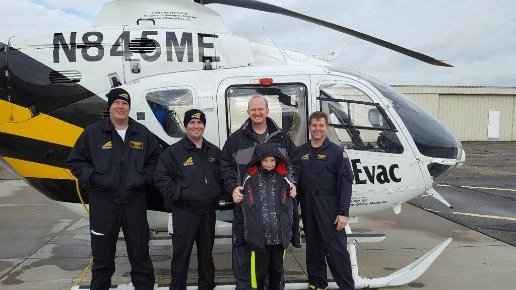 TOUR TAKEN — Chris Mockbee, second from right, and his son Sam posed with the crew of STAT MedEvac during the Aviation Explorer Post 787's tour at its February meeting. -- Contributed
