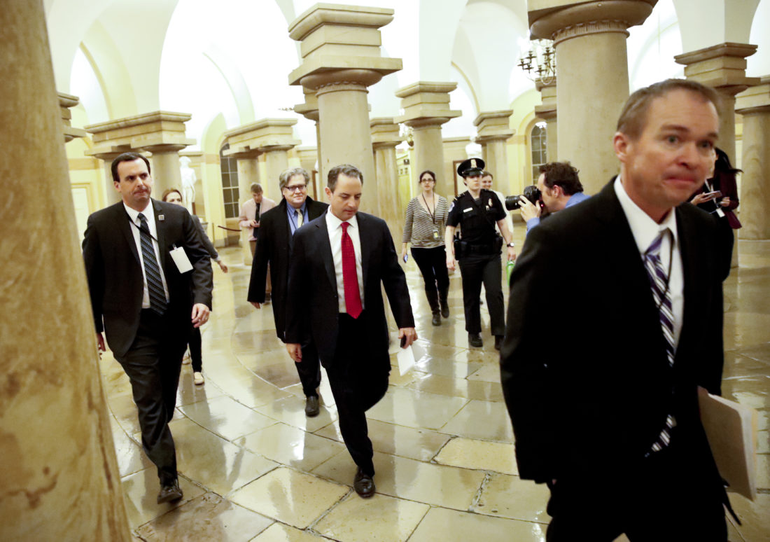 ONE MORE MEETING — Office of Management and Budget Mick Mulvaney, right, White House Chief of Staff Reince Priebus, and White House chief strategist Steve Bannon, depart after a Republican caucus meeting on Capitol Hill, Thursday, in Washington. -- Associated Press