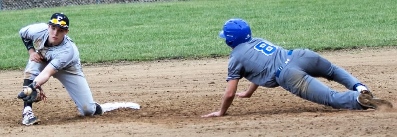 Jimmy Joe Savage SPRING BASEBALL — Edison shortstop Joey Nave waits to receive a throw as East Liverpool's Austin Bombich slides into second base during Monday's game. The Wildcats defeated the Potters, 15-0, in five innings as Tristan Haught tossed a no-hitter.
