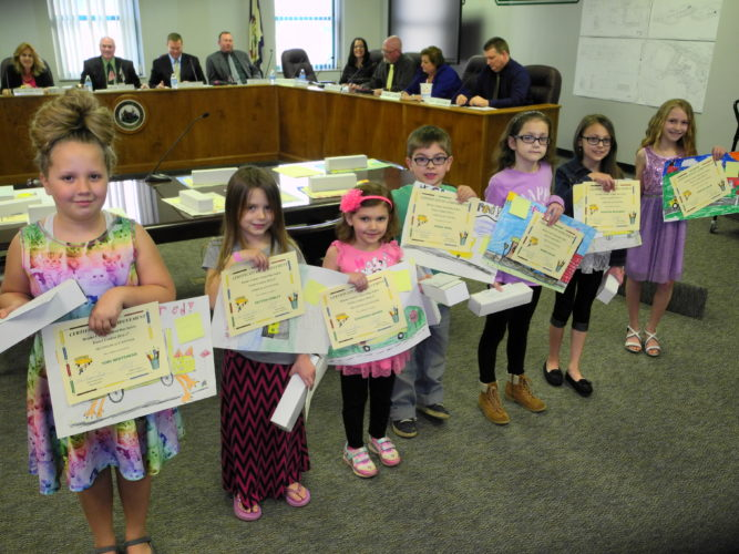 BUS SAFETY WINNERS — Winners of Brooke County Schools' school bus safety poster contest included, from left, Tori Whitehead and Peyton Conley, both of Beech Bottom Primary School; Givanna Brown and Derek Sperl, both of Colliers Primary School; Andrea Bolen of Franklin Primary School; Morgan McKinney and Brielee Shaw, both of Hooverson Heights Primary School. -- Warren Scott