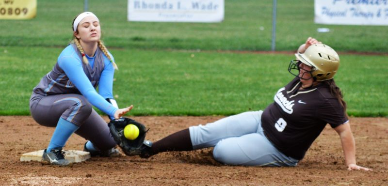 CLOSE PLAY — John Marshall's Lauren Garcia slides safely into second base as Oak Glen's Taylor McKay awaits the throw during Tuesday's contest, won by the Monarchs. (Josh Strope)