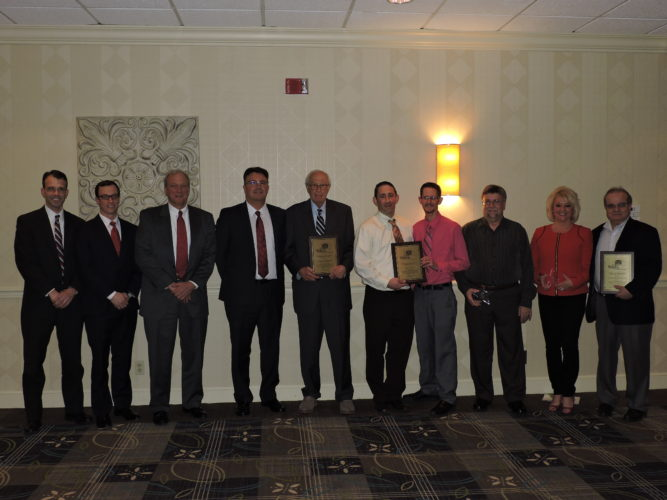 HONORED BY CHAMBER — As part of Tuesday's membership dinner, the Weirton Chamber recognized several individuals and businesses for their contributions. Pictured, from left, are Thomas J. Decapio, Carl A. Frankovitch, Eric Frankovitch, Michael Simon, and George J. Anetakis, of Frankovitch, Anetakis, Simon, Decapio & Pearl LLP; John A. Newbrough and Jason Exner of Newbrough Photo; volunteer Walter Ruszkowski; outgoing board member JoAnn Babela and Nick Latousakis of All Saints Greek Orthodox Church -- Craig Howell