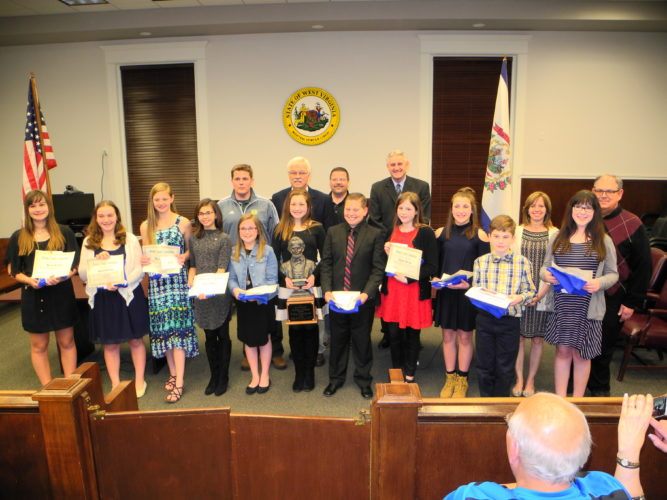 PUBLIC SPEAKING SKILLS SHOWN — Participating in the 53rd-annual Brooke County Gettysburg Address Speech Contest were, front, from left, sixth graders Bailey Serevicz, Hannah Butterbaugh, Ava Bolen, Olivia Bain, Nikena Croce, who placed second; Olivia Shafer, the contest's winner; George Kamarados, who placed third; Abigail Kerns, Vanessa Polen, Noah Conaway and Mackenzie Sargent; and back, Joseph Wade, a judge; Kevin Elias, a judge;  Jim McFadden, coordinator; Brooke County Commissioners Tim Ennis and Stacey Wise and Fred Welshans, a judge. -- Warren Scott