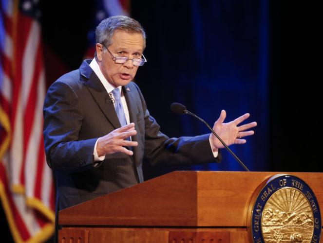 "NEW BOOK — Gov. John Kasich delivers his State of the State address at the Sandusky State Theatre April 4.  Kasich's ""Two Paths: America Divided or United"" is being published today. The book reflects on Kasich's career and a wide range of issues. -- Associated Press"