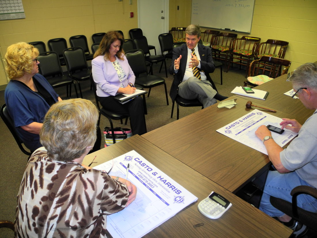 WARNER IN WELLSBURG — West Virginia Secretary of State Mac Warner spoke to Brooke County officials Monday about efforts to clear voter registration records of those who are deceased and rendered ineligible because they have been convicted of a crime. With Warner, second from right, are, from left, county Clerk Sylvia Benzo; county Election Clerk Pam Northcraft; Penny Brick, field service representative for the secretary of state's office; and county  -- Warren Scott