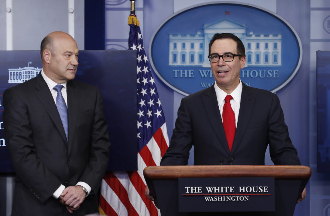TAX TALK — Treasury Secretary Steven Mnuchin,  right, joined by National Economic Director Gary Cohn, speaks in the briefing room of the White House, Wednesday. President Donald Trump is proposing dramatically reducing the taxes paid by corporations big and small in an overhaul his administration says will spur economic growth and bring jobs and prosperity to the middle class. -- Associated Press